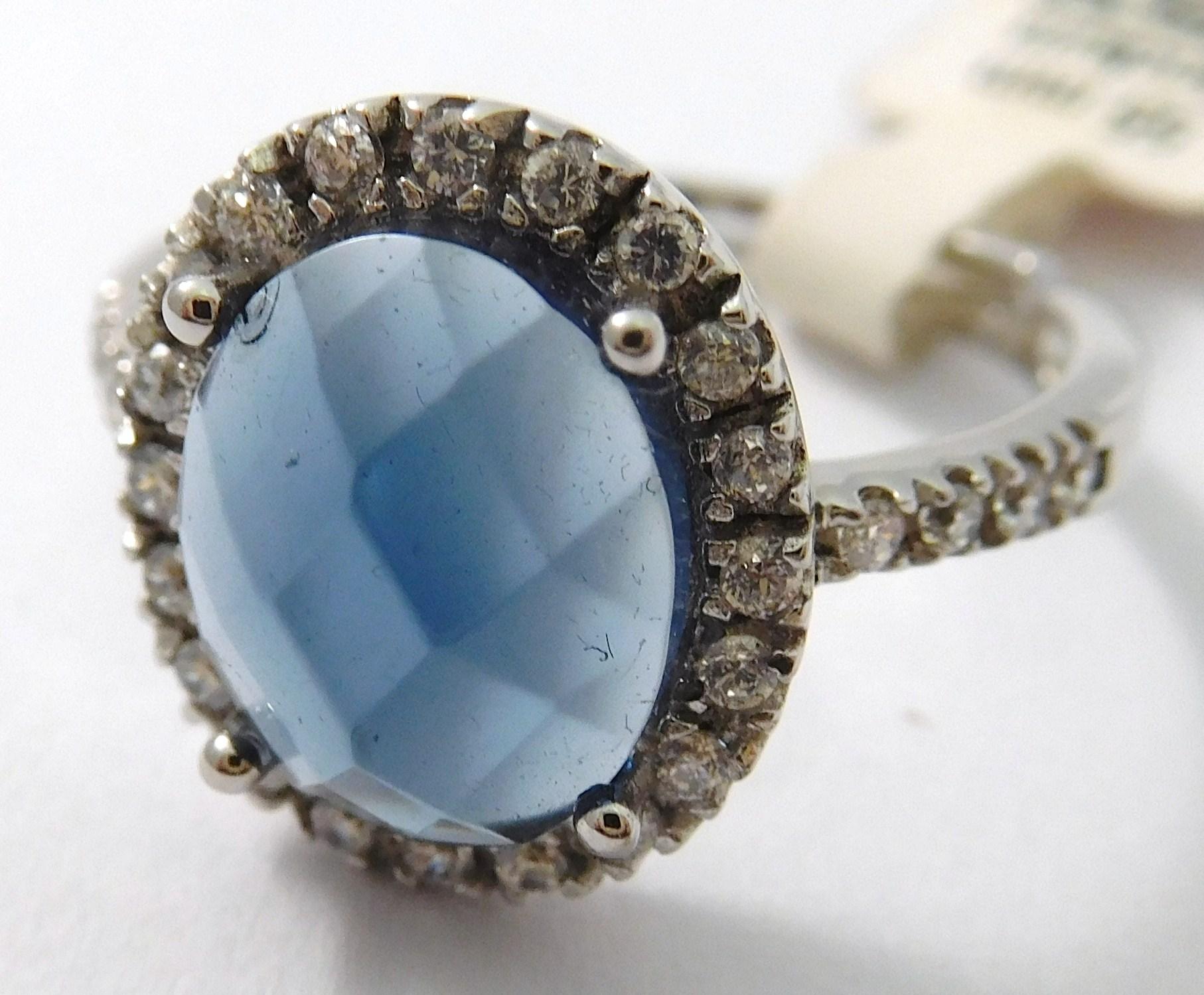 Stříbrný prsten se syntetickým modrým zikonem vel.55 F340 (otevírací) (030085300006)