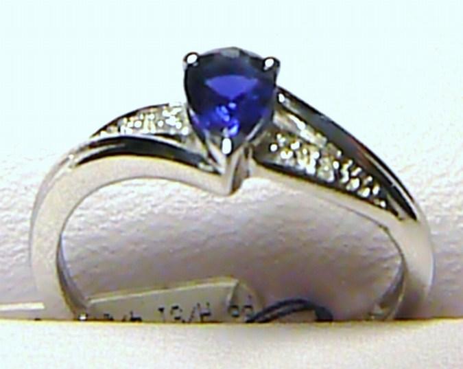 Diamantový prsten z bílého zlata s velkým modrým safírem 585/2,0g - safír 0,49ct (1949.0.53.92)
