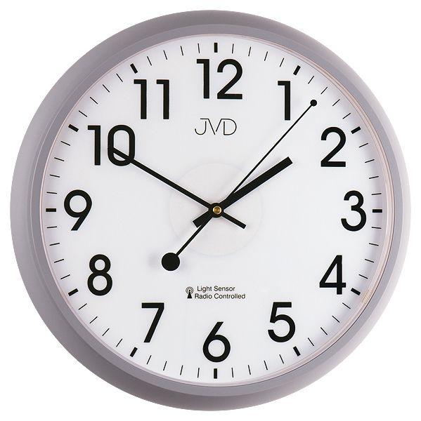 Šedé rádiem řízené nástěnné hodiny JVD RH698.2 s podsvícením a senzorem stmívání